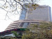 Sensex, Nifty in green, financials drag