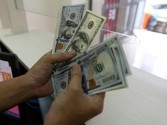 Chinese yuan edges higher against US dollar